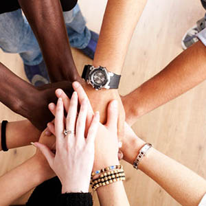 Team hands in together