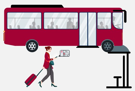 A woman looking at the travel information on her phone next to the bus